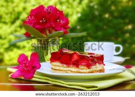 Mother's Day cake in the summer garden. - stock photo