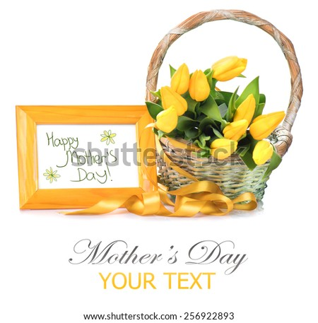Mother's Day greeting card - a basket of tulip spring flowers. Bouquet of yellow tulips. Easter. Springtime. Beautiful holiday gift isolated on white background - stock photo