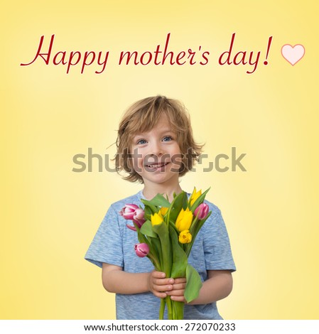 Mother's day greetings: little boy holding a tulips bouquet  - stock photo