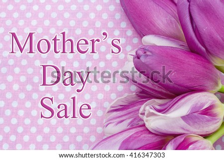Mother's Day Sale Message, Some tulips with pink polka dots and text Mother's Day Sale - stock photo