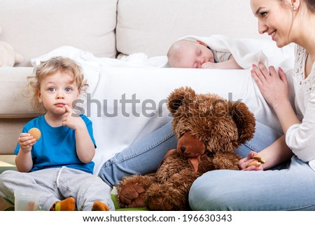 Mother's free time with children in living room - stock photo