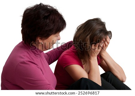 Mother (senior woman) comforts her worried adult daughter - isolated on white - stock photo