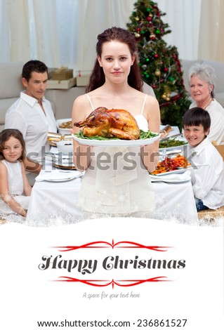 Mother showing turkey for Christmas dinner against border - stock photo