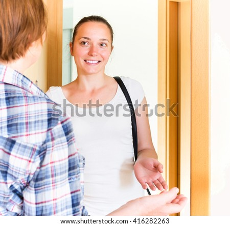 Mother smiling welcomes her young daughter - stock photo
