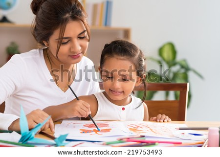 Mother spending time with her little daughter - stock photo