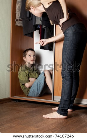 Mother, swears at his son at home - stock photo