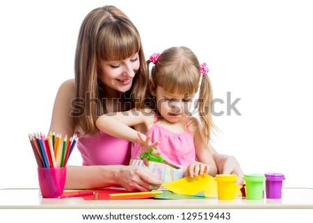 Mother teaches preschooler kid to do craft items. DIY concept. - stock photo