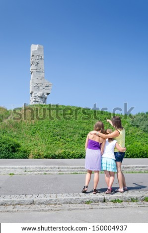 Mother teaching daughters the Westerplatte history - stock photo
