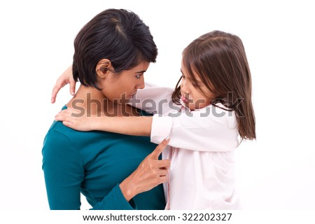 mother teaching discipline to her daughter - stock photo