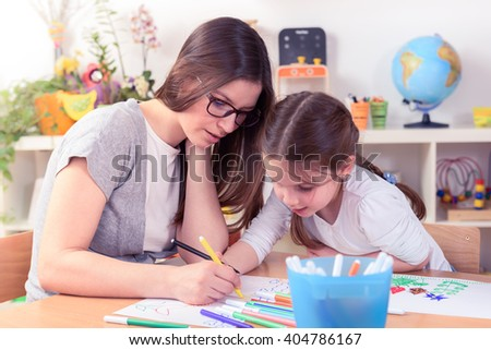Mother Teaching Her Daughter Drawing Flowers - stock photo