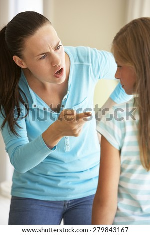 Mother Telling Off Daughter At Home - stock photo