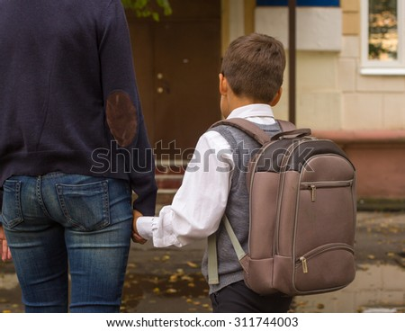 Mother  Walking To School With Children - stock photo
