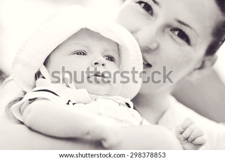 mother walking with sweet little baby boy