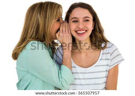 mother whispering something at his daughter - stock photo