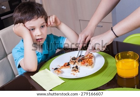Mother who cut off her son's pizza - stock photo