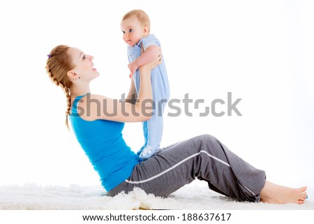 mother with a child engaged in yoga. doing exercises. isolated on white background - stock photo