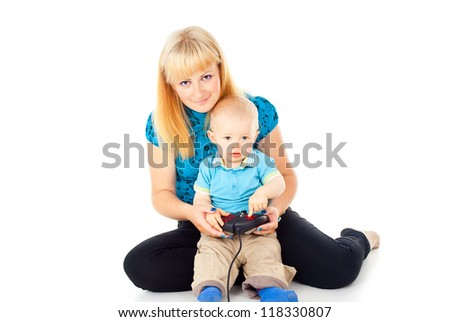 mother with a child playing on the joystick - stock photo