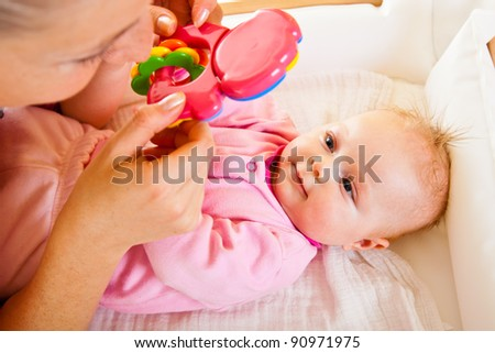 Mother with baby girl isolated on white - stock photo