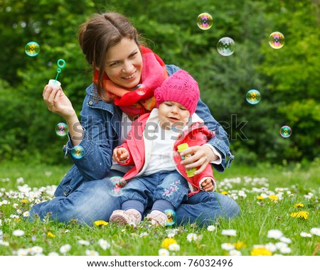 Mother with baby in the park - stock photo