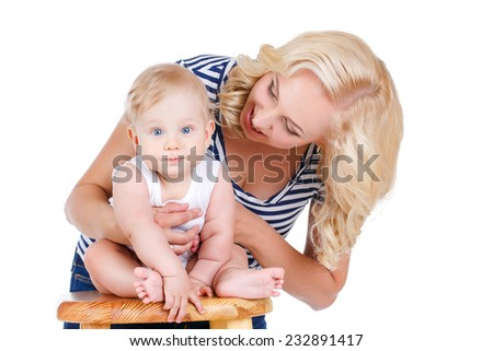 Mother with baby isolated on white. Happy mother and daughter playing on the white background. Happy family. A young mother and baby rests - stock photo