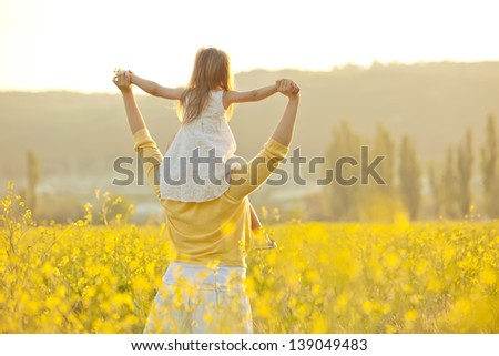 Mother with baby on nature - stock photo