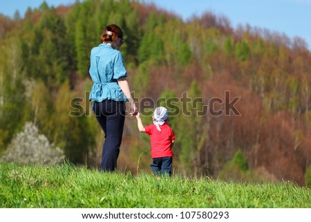 Mother with baby - Walk in the mountains - stock photo