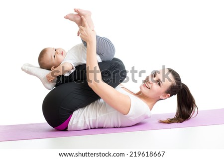 mother with child do gymnastic and fitness exercises - stock photo