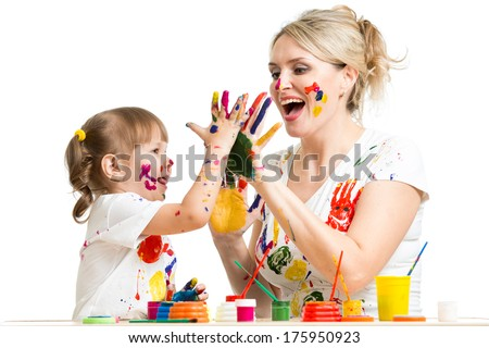 Mother with child paint and have fun pastime - stock photo