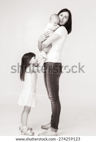Mother with children black and white full length portrait - stock photo