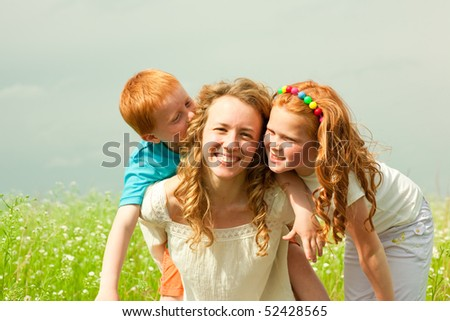 mother with children goes on field - stock photo