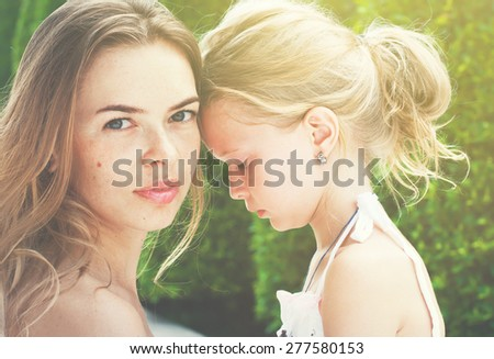 Mother with Daughter in the Difficult Situation. Toned image - stock photo