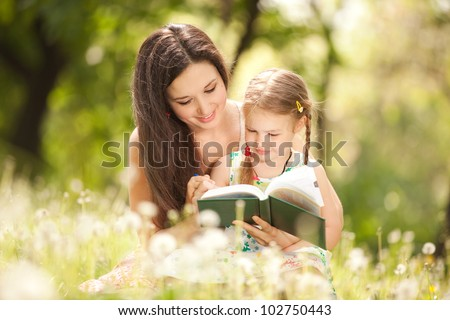Mother with daughter in the park - stock photo