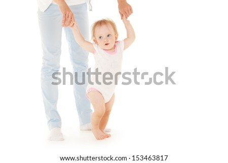 Mother with daughter on the white background. First steps. - stock photo