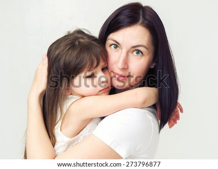 Mother with daughter portrait child - stock photo