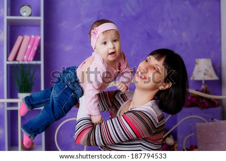 Mother with daughter relaxing at home - stock photo