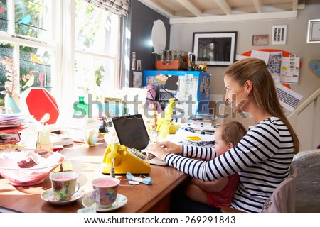 Mother With Daughter Running Small Business From Home Office - stock photo