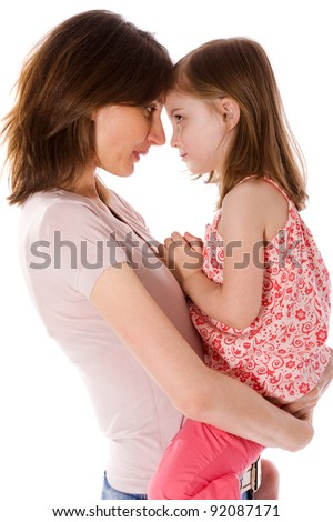 Mother with daughter sharing secrets isolated on white - stock photo