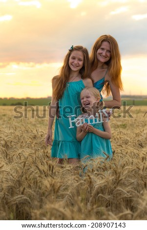 mother with daughters outdoors   - stock photo