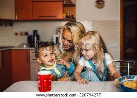 Mother with family haveing fun at kitchen - stock photo