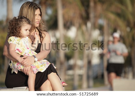 Mother with her adorable little daughter - stock photo