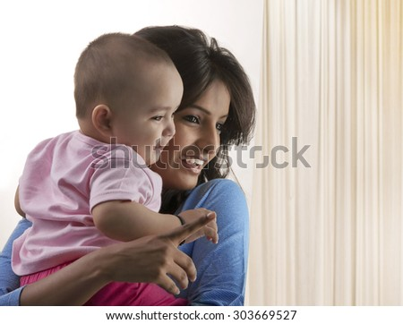 Mother with her baby - stock photo