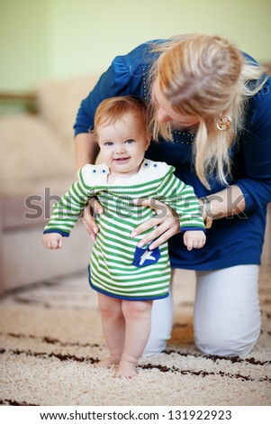 Mother with her baby at home - stock photo