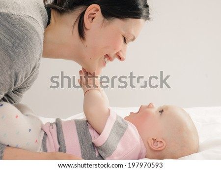 mother with her baby on white background - stock photo