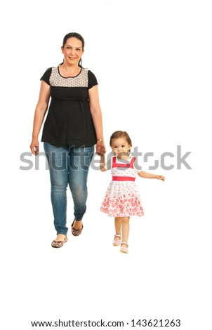 Mother with her daughter walking together isolated on white background - stock photo