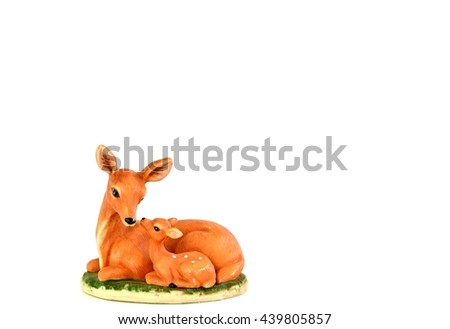 mother with her infant (deer pottery doll ) - stock photo
