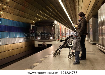 Mother with her son waiting a train at subway station in Prague - stock photo
