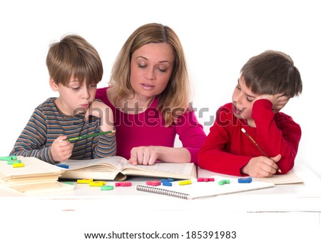mother with her sons, reading a book - stock photo