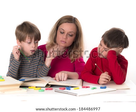 mother with her sons reading a book, partly isolated, studio shot - stock photo