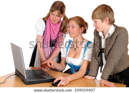 Mother with her two children and laptop - stock photo