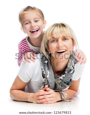 mother with little daughter smiling over white background - stock photo